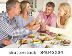 mid age couples enjoying meal... | Shutterstock . vector #84043234