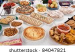 picnic fare being laid out on... | Shutterstock . vector #84047821