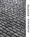 Old English cobblestone road in Plymouth close up. - stock photo