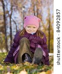 Little Girl Sitting On Leaves...