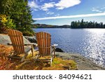 Stock photo adirondack chairs at shore of lake of two rivers ontario canada 84094621