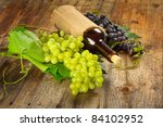 Arrangement of grapes and a bottle of wine - stock photo