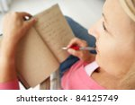 senior woman writing in notebook | Shutterstock . vector #84125749