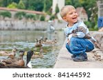 Cute Little Boy Feeding Ducks...