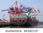 loading of a container ship in the port of Hamburg, Germany - stock photo