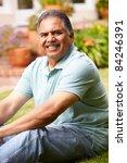mid age man relaxing in garden | Shutterstock . vector #84246391