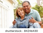 senior couple relaxing in garden | Shutterstock . vector #84246430