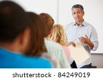 tutor with class of students | Shutterstock . vector #84249019