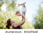 mother with baby at outdoor | Shutterstock . vector #84269668