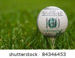 hundred dollars on golf ball - stock photo