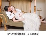 bride and groom on a sofa... | Shutterstock . vector #843559