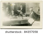 Vintage photo of employees in accounting office (thirties) - stock photo