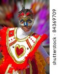 Small photo of NASSAU, BAHAMAS - JAN 1- unidentified Young girl in festive costume dances in Junkanoo, a traditional Bahamian Carnival Parade on Jan 1 in Nassau, Bahamas.