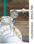 Small photo of pressure gauge top of the white aboveground pipe.