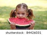 beauty little girl eat... | Shutterstock . vector #84426031