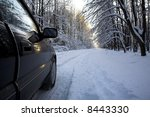 sunny day in the snow-covered winter forest - stock photo