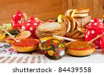 Pancake with red caviar and tea during  Shrovetide - stock photo