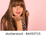 cute girl in dress posing on a... | Shutterstock . vector #84453715