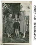Vintage photo of three generations family (fifties) - stock photo