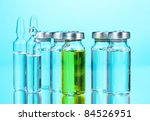 medical ampoules on blue... | Shutterstock . vector #84526951