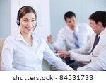 Young attractive girl with a cool center in the office - stock photo