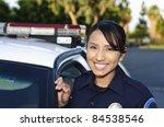 A Smiling Hispanic Police...