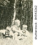 Vintage photo of brothers playing outdoor (fifties) - stock photo
