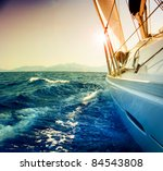 yacht sailing against sunset... | Shutterstock . vector #84543808