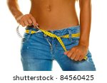 A Slender Young Woman In Jeans...