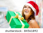 young smiling woman holding... | Shutterstock . vector #84561892