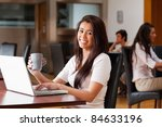 cute woman using a laptop in a...   Shutterstock . vector #84633196