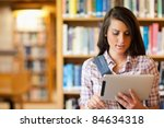 young focused student using a... | Shutterstock . vector #84634318