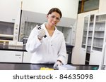smiling scientist pouring a... | Shutterstock . vector #84635098
