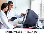 female scientists looking at a... | Shutterstock . vector #84636151