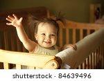 baby girl waving hand and... | Shutterstock . vector #84639496