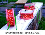 Pink and decorated drums laying on white bench - stock photo