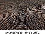 Zoomed photo of worn rope rolled in circle - stock photo