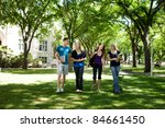 Stock photo students walking through campus visiting 84661450