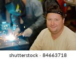 smiling welder with a welding... | Shutterstock . vector #84663718