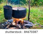 two touristic cauldron in a fire | Shutterstock . vector #84670387