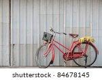 Red Vintage Bicycle At Grunge...