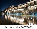 Night scene of traditional village building near the river in Wuzhen town, Zhejiang province, China - stock photo