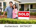 hispanic couple outside home... | Shutterstock . vector #84704197