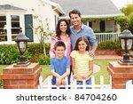 hispanic family outside home | Shutterstock . vector #84704260
