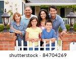 hispanic family outside home | Shutterstock . vector #84704269