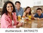 Hispanic Family Eating Breakfast
