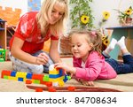 teacher and child are playing... | Shutterstock . vector #84708634