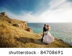 kissing wedding couple staying... | Shutterstock . vector #84708691