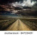 Rural Road Through A Field At...