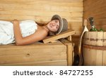 young woman lying on wooden... | Shutterstock . vector #84727255
